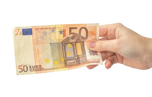 Vijftig euro biljet in de hand geïsoleerd op een witte achtergrond, vrouw hand met bankbiljet, europa geld photo