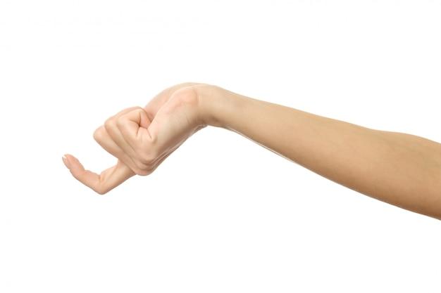 Vinger die reikt of krabt. vrouwenhand gesturing geïsoleerd op wit