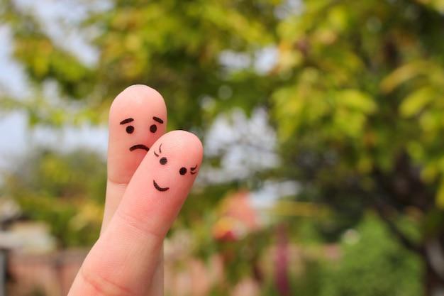 Vingerkunst van paar. vrouw is vrolijk, man is verdrietig.