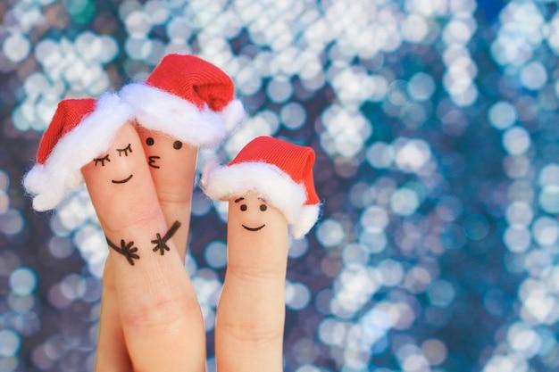 Vingerskunst van familie viert kerstmis.