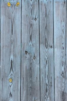 Vintage achtergrond van grijze houten verticale shabby plank