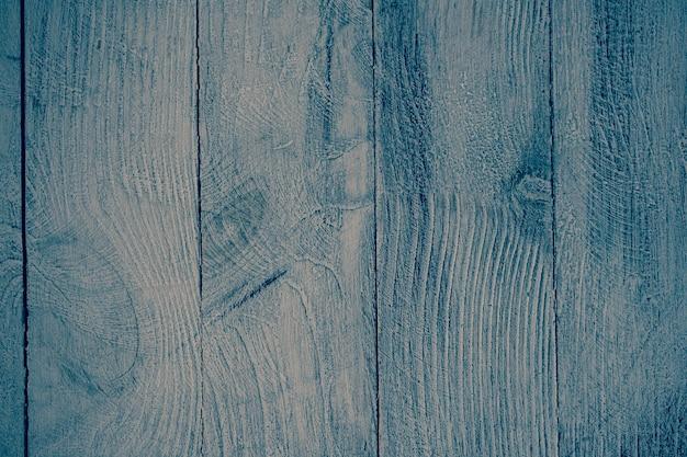Vintage blauwe houten achtergrondstructuur met knopen en spijkergaten. oude geschilderde houten muur.