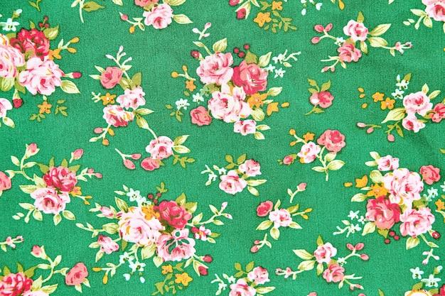 Vintage bloemenstof, fragment van kleurrijk retro tapijtwerk textielpatroon met bloemenbac
