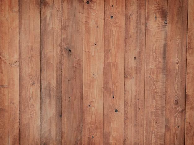 Vintage bruine houtstructuur achtergrond met knopen.