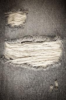 Vintage gescheurde denim jeans textuur.