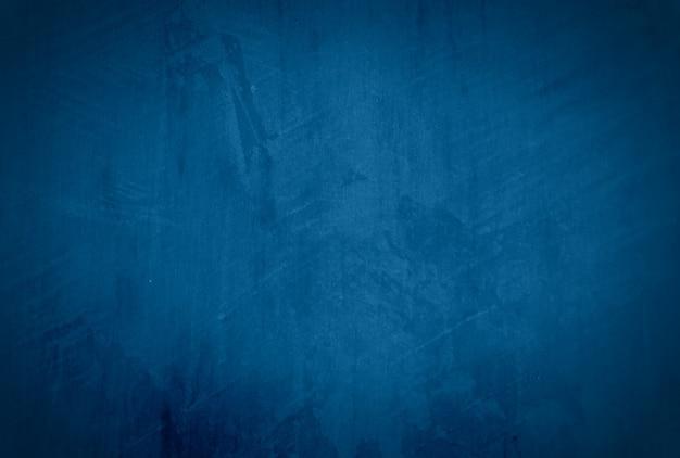 Vintage grunge blauwe betonnen textuur muur achtergrond met vignet.