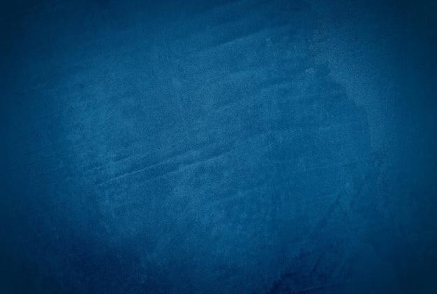 Vintage grunge blauwe concrete textuur studio muur achtergrond met vignet.
