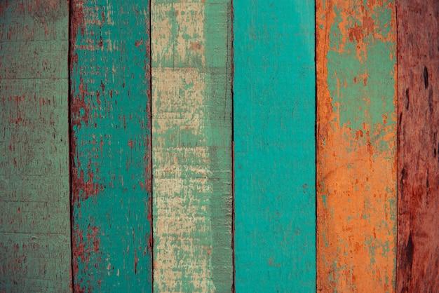 Vintage houtstructuur oud hout materiaal of vintage behang kleuren patroon van felgekleurde panelen van verweerde geschilderde houten planken