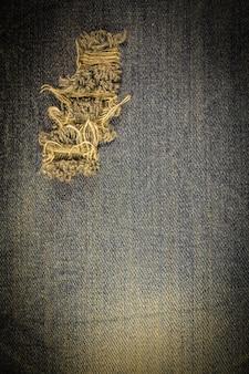 Vintage jeans gescheurde denim textuur.