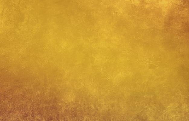Vintage luxe gouden textuur achtergrond met gouden verloop. oranje en gele textuur