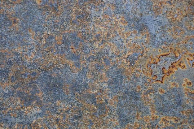 Vintage muur met verweerde kleuren en roest blauw grijs en oranje graniet achtergrond oude kleurrijke getextureerde oppervlak zoals corrosie abstracte grunge roestige metalen achtergrond voor meerdere toepassingen