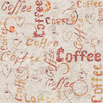 Vintage oud papier koffieblad met belettering, hartjes, koffiekopjes en kopjes sporen