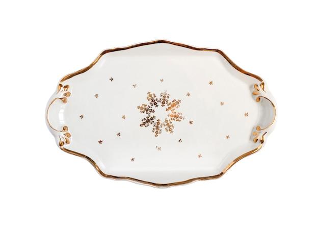 Vintage porseleinen kerst dienblad met decor geïsoleerd op een witte achtergrond met uitknippad. plat lag, bovenaanzicht.