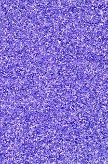 Violette decoratieve pailletten. afbeelding met glanzende bokeh lichten van kleine elementen