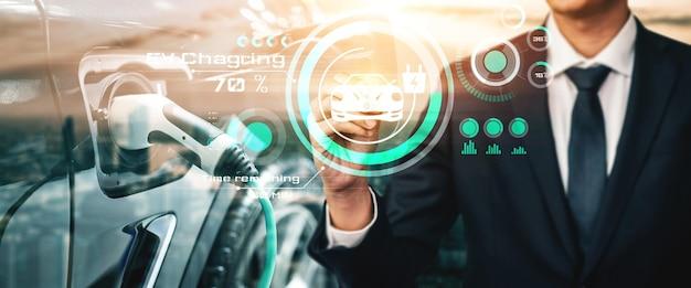 Virtual reality-concept elektrische auto met ev-laadstation voor groene stroom en ecostroom geproduceerd uit duurzame bron tot levering aan laadstation om co2-uitstoot te verminderen.