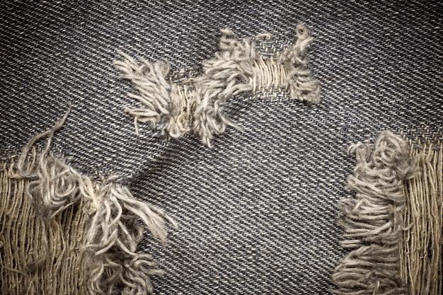 Vitage gescheurde denim jeans textuur.