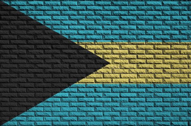 Vlag van bahama's is geschilderd op een oude bakstenen muur