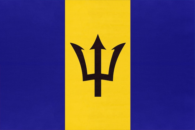 Vlag van barbados nationale stof, textiel achtergrond. symbool van de amerikaanse wereld.