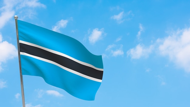 Vlag van botswana op paal. blauwe lucht. nationale vlag van botswana