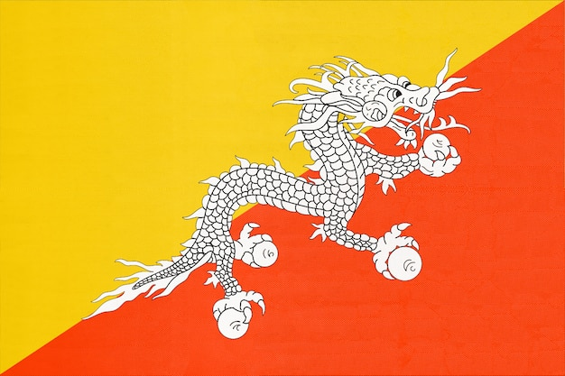 Vlag van butaan nationale stof, textiel achtergrond. officieel teken van de aziatische staat.