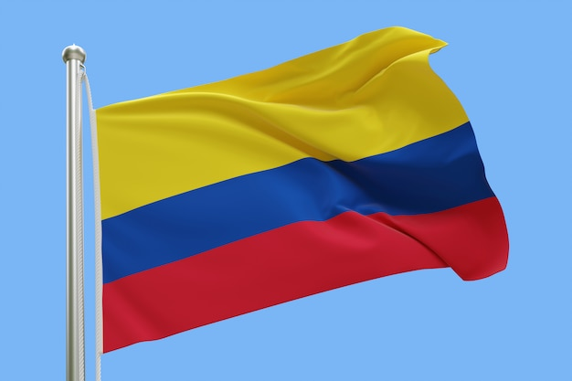 Vlag van colombia op vlaggenmast zwaaien in de wind. geïsoleerd op blauwe hemel