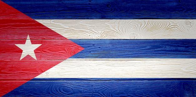 Vlag van cuba geschilderd op oude houten plank achtergrond
