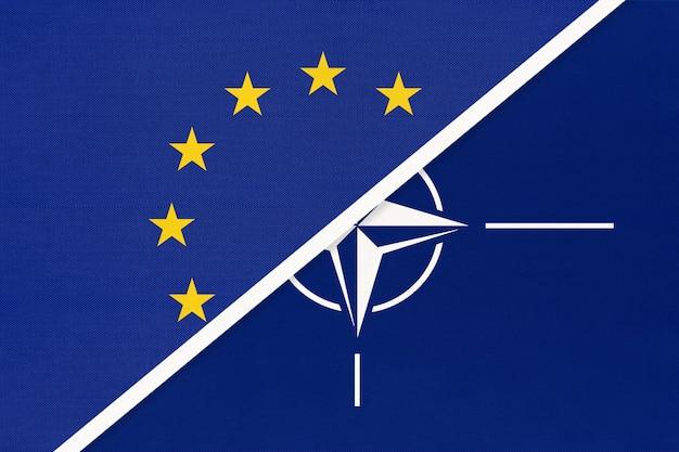 Vlag van de europese unie of eu en nationale stoffen versus noord-atlantische verdragsorganisatie