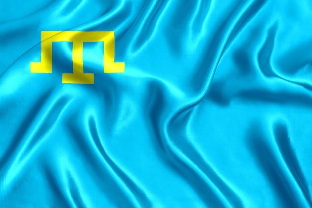 Vlag van de krim-tataren zijde close-up achtergrond