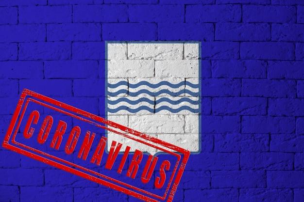 Vlag van de regio's van italië basilicata met originele verhoudingen. gestempeld met het coronavirus. bakstenen muur textuur. corona-virusconcept. op de rand van een covid-19- of 2019-ncov-pandemie.