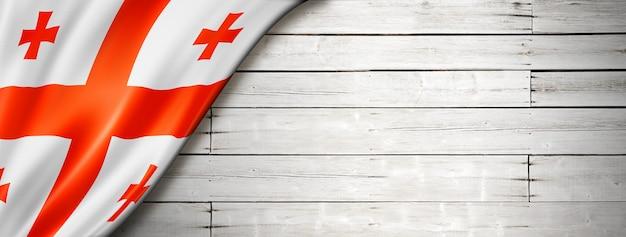 Vlag van georgië op oude witte muur. horizontale panoramische banner.