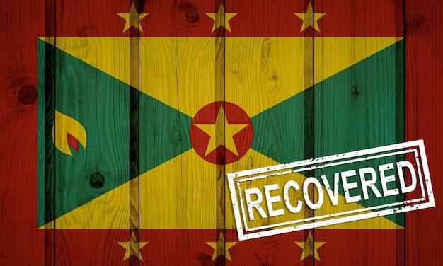 Vlag van grenada die de infecties van de coronavirusepidemie of het coronavirus heeft overleefd of hersteld. grunge vlag met stempel hersteld