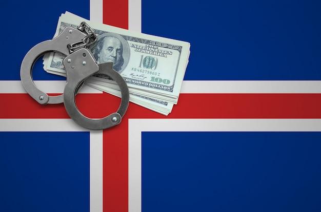 Vlag van ijsland met handboeien en een bundel dollars. het concept van het overtreden van de wet en dieven misdaden