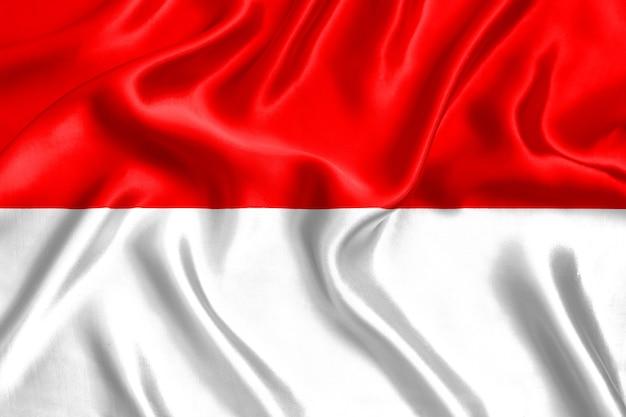 Vlag van indonesië zijde close-up achtergrond