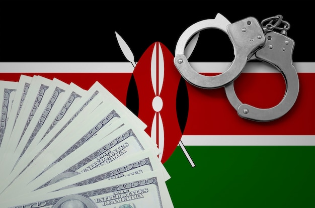Vlag van kenia met handboeien en een bundel dollars. het concept van illegale bankactiviteiten in amerikaanse valuta