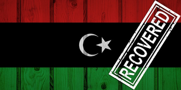 Vlag van libië die de infecties van de coronavirusepidemie of het coronavirus heeft overleefd of hersteld. grunge vlag met stempel hersteld