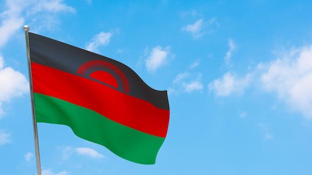 Vlag van malawi op paal. blauwe lucht. nationale vlag van malawi