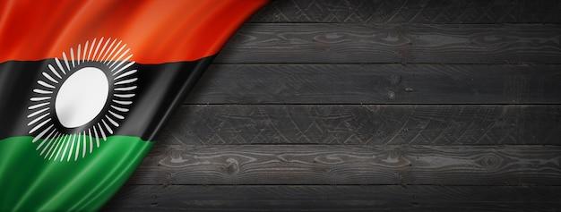 Vlag van malawi op zwarte houten muur