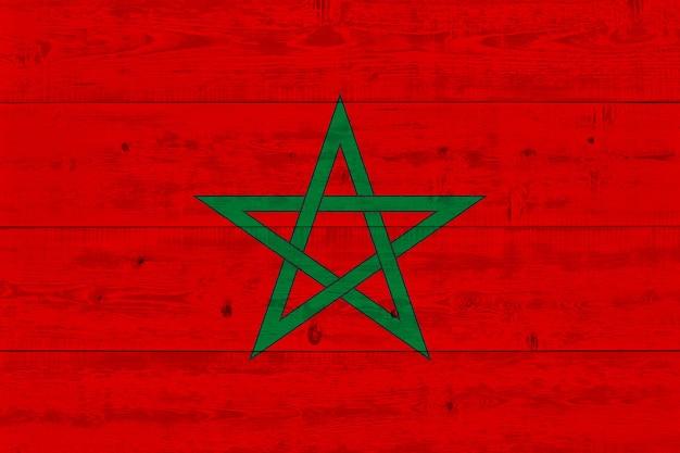Vlag van marokko geschilderd op oude houten plank