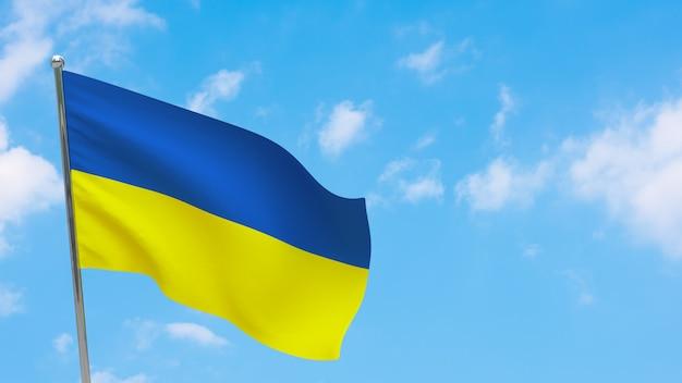 Vlag van oekraïne op paal. blauwe lucht. nationale vlag van oekraïne