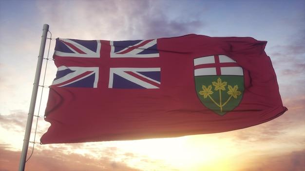 Vlag van ontario, canada, zwaaiend in de wind, lucht en zon achtergrond. 3d-rendering