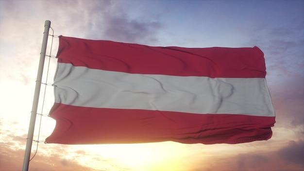 Vlag van oostenrijk zwaaien in de wind, lucht en zon achtergrond. 3d-rendering.