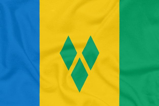 Vlag van saint vincent en de grenadines op geweven stof. patriottisch symbool
