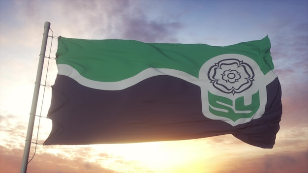 Vlag van south yorkshire, engeland, zwaaiend in de wind, lucht en zon achtergrond. 3d-rendering