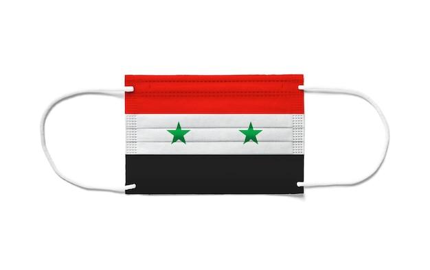 Vlag van syrië op een chirurgisch wegwerpmasker