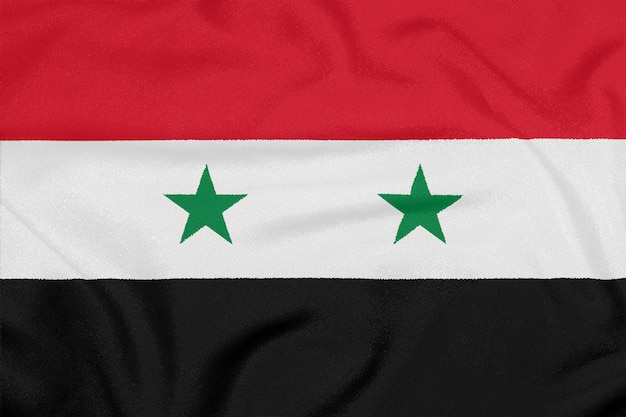 Vlag van syrië op geweven stof. patriottisch symbool