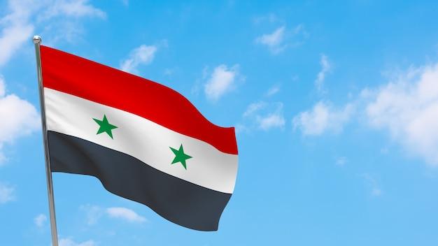 Vlag van syrië op paal. blauwe lucht. nationale vlag van syrië