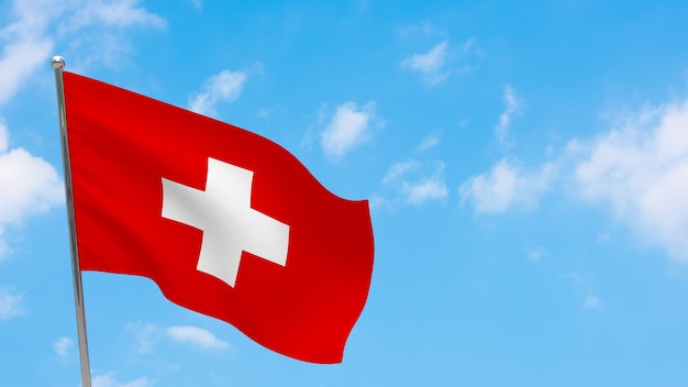 Vlag van zwitserland op paal. blauwe lucht. nationale vlag van zwitserland