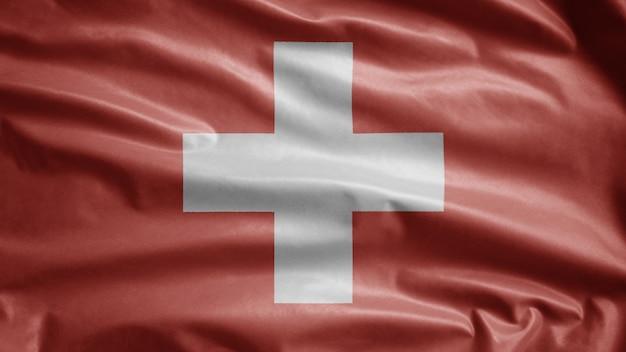 Vlag van zwitserland zwaaien in de wind