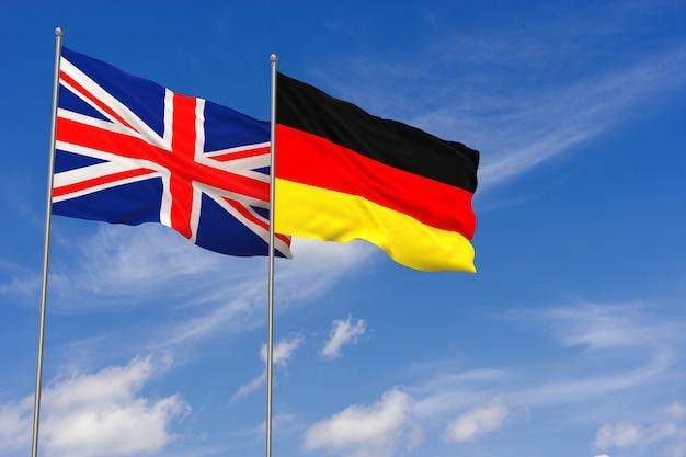 Vlaggen van het verenigd koninkrijk en duitsland over blauwe hemelachtergrond. 3d illustratie