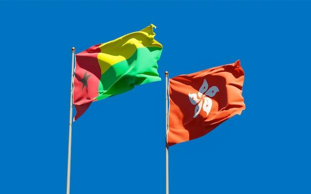 Vlaggen van hong kong hk en guinee-bissau. 3d-illustraties
